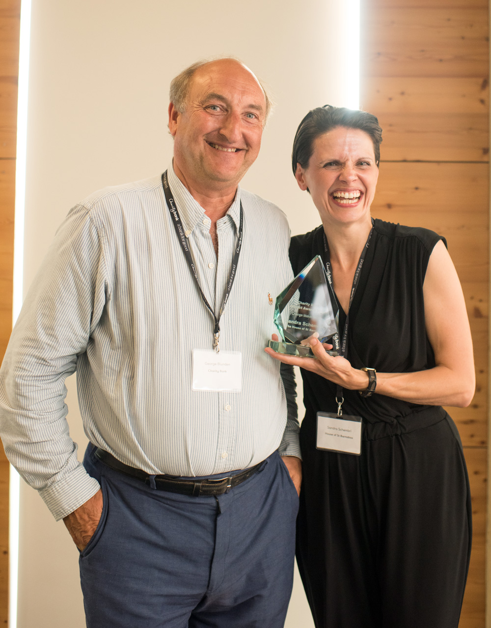 George Blunden, Chairman of Charity Bank is pictured with Sandra as she accepted her award.